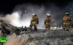 Разбор завалов на месте крушения Boeing 737. Кадр телеканала Russia Today