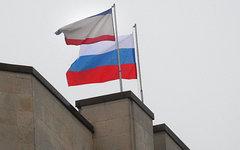 Российский флаг над зданием Совета министров в Симферополе © РИА Новости, Тарас