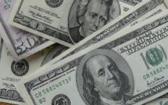 Доллары. Фото с сайта sunhome.ru