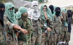 Члены группировки Los Rastrojas. Фото с сайта dialogo-americas.com