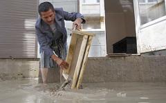 Житель затопленного поселка © РИА Новости, Геннадий Аносов