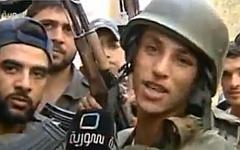 Боец сирийской армии дает интервью. Стоп-кадр с видео в YouTube