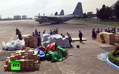Гуманитарная помощь в зоне бедствия. Кадр телеканала Russia Today