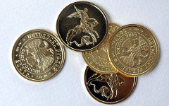 Золотые монеты «Георгий Победоносец». Фото с сайта bartural.ru