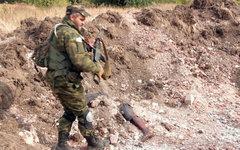 На месте захоронения мирных жителей около шахты «Коммунар» © РИА Новости/Ruptly