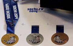 Медали зимней Олимпиады-2014 на презентации в Санкт-Петербурге © РИА Новости, Иг
