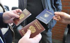 Получение паспортов РФ жителями Крыма © РИА Новости, Сергей Кузнецов