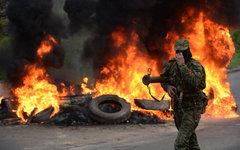 Ополченец на блокпосту под Славянском © РИА Новости, Михаил Воскресенский