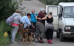 Местные жители эвакуируются из Лисичанска © РИА Новости, Евгений Биятов