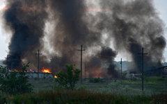 Пожар на складе боеприпасов в Луганской области © РИА Новости, Евгений Биятов