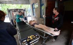 Раненый в ходе боестолкновений ополченец © РИА Новости, Михаил Воскресенский