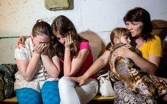 Жители Славянска в подвале школы во время обстрела © РИА Новости, Андрей Стенин