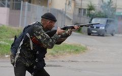 Ополченец во время боев под Луганском © РИА Новости, Евгений Биятов