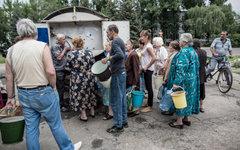 Жители Славянска в очереди за водой © РИА Новости, Андрей Стенин