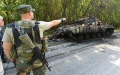 Подбитый ополченцами танк украинской армии на окраине Донецка © РИА Новости, Мих