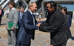 Владимир Путин и Стивен Сигал © РИА Новости, Алексей Дружинин