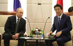 Владимир Путин с премьер-министром Японии Синдзо Абэ.